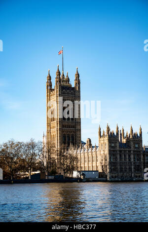 Victoria Tower, part of the Palace of Westminster on the northern bank of the Thames - Stock Image