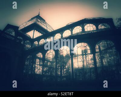 A moody, atmospheric & possibly ghostly image of the Palacio de Cristal (Crystal Palace) in Buen Retiro Park, Madrid, Spain. A famous tourist destination which has many uses. Photo © COLIN HOSKINS. - Stock Image