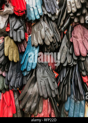 Leather gloves for sale on a market stall - Stock Image