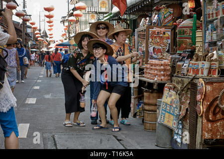 Tourists for for photos at Huay Yai Chinese street market, Pattaya, Thailand, Southeast Asia - Stock Image