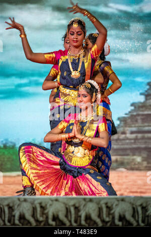 Vertical view of beautiful Bharatanatyam dancers performing during Pongal festivities in India. - Stock Image