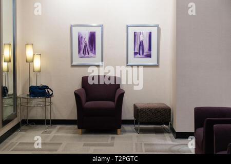The waiting room outside of a dressing room at J.C. Penny's department store in the USA. - Stock Image