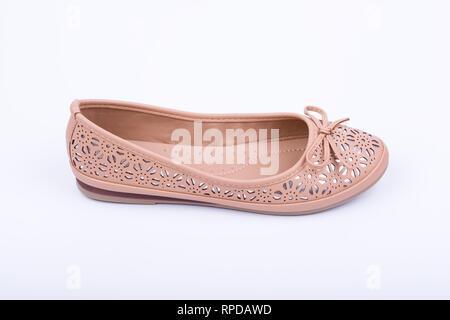 Fashionable female flat shoe on white background. - Stock Image