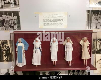 Exhibit of nuns habits over the years displayed on dolls at the museum on Bathurst Island, one of the Tiwi Islands. - Stock Image