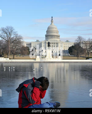 View of Frozen Reflecting Pool in front of US Capitol in Washington DC - Stock Image
