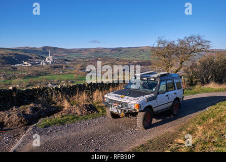 Land Rover on a Green Lane with Breedon Hope Cement Works in distance. Near Bradwell, Peak District National Park, Derbyshire, England. - Stock Image