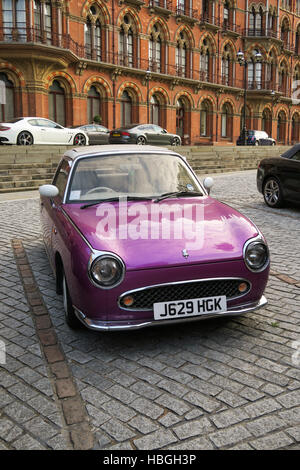 A Nissan Figaro classic Japanese car photographed in London, UK. - Stock Image