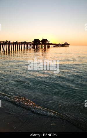 Naples Pier sunset Florida Naples Municipal Pier sunset Naples Fishing Pier fl southwest florida gulf coast silhouette - Stock Image