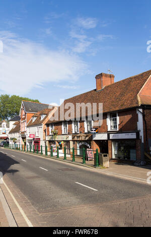 High Street in the small town of Fordingbridge, Hampshire, with various small shops. - Stock Image