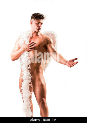 Male angel with white wings isolated in studio shot - Stock Image
