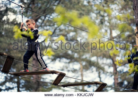 boy on rope bridge - Stock Image