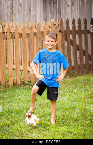 boy with soccer ball - Stock Image