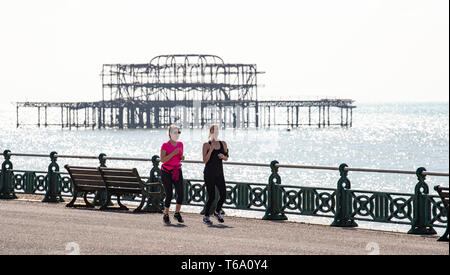Brighton UK 30th April 2019 - Runners enjoy the warm sunny weather this morning on Hove seafront with it forecast to reach into the high teens in some parts of the South East today. Credit: Simon Dack/Alamy Live News - Stock Image