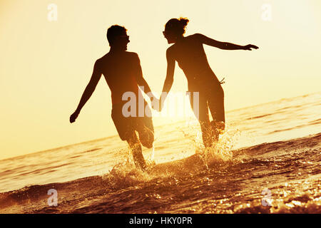 Happy couple sunset sea run - Stock Image