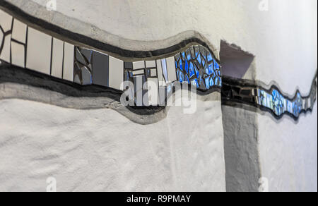 Uelzen, Germany, December 21., 2018: Wave of black, grey and blue tiles in the sanitary area of the station of the small town Uelzen - Stock Image