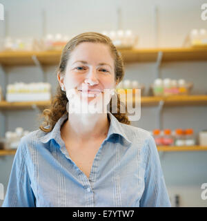 Portrait of mid-adult woman in laboratory - Stock Image