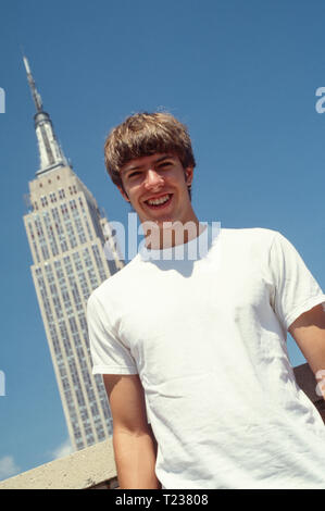 Teenage Boy Touring NYC in front of the Empire State Building, USA , 2002 - Stock Image