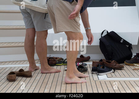 Southampton, UK. 11th September 2015. Southampton Boat Show 2015. Show visitors collect their shoes after viewing - Stock Image