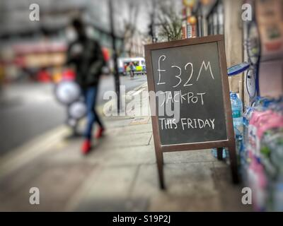 National Lottery notice in High Street, London - Stock Image