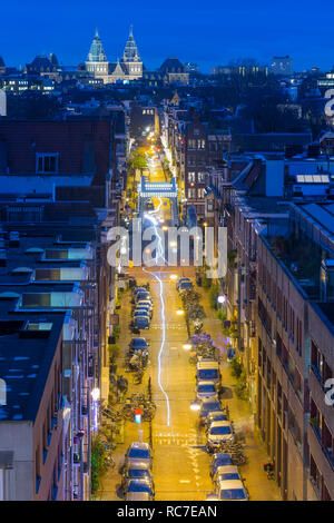 Amsterdam street at night with Skinny Bridge (Mager Brug) and Rijksmuseum. High angle view. - Stock Image