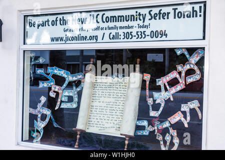 Miami Beach Florida 41st Street Arthur Godfrey Road Jewish Learning Center Chabad window display fundraiser Torah writing religi - Stock Image