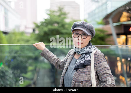 Fashionable Taiwanese woman of Chinese ethnicity out on the town - Stock Image