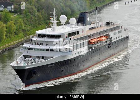 Cruiseship Minerva passing the Kiel Canal. - Stock Image