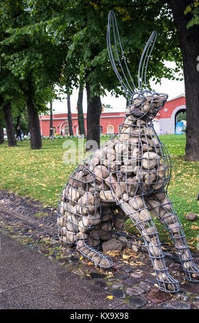 Large hare artwork made from gabion baskets and stones, displayed inside grounds of Peter and Paul Fortress, Zayachy - Stock Image