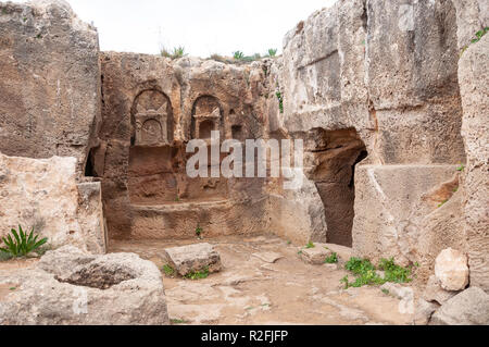 Carved rock tomb in The Tombs of the Kings, Tombs of the Kings Avenue, Paphos (Pafos), Pafos District, Republic of Cyprus - Stock Image