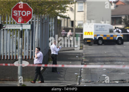 Police detectives at the scene in Londonderry, Northern Ireland, where 29-year-old journalist Lyra McKee was shot and killed when guns were fired and petrol bombs were thrown in what police are treating as a 'terrorist incident'. - Stock Image