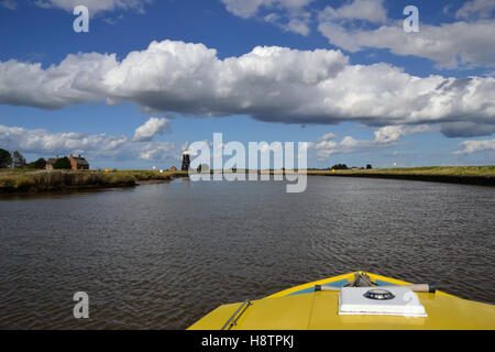 Bow of a yellow boat on the River Yare heading towards Berney Arms Mill on the Norfolk Broads - Stock Image