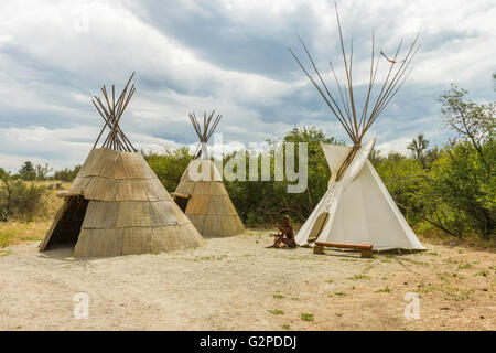 Native teepees display on self-guided desert terrain walk at NK'MIP Desert Cultural Centre, Osoyoos BC Canada. - Stock Image