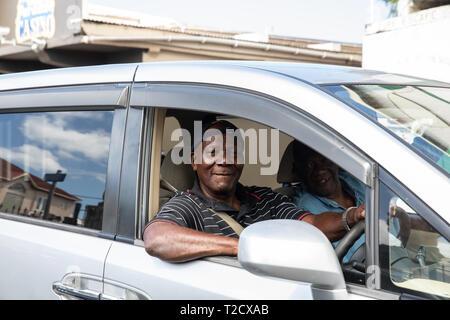 Cab driver smiling in Saint John's, Capital of Antigua and Barbuda - Stock Image