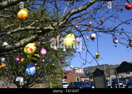 Deocrated eggs on trees in Princes Risborough, Buckinghamshire, UK. Created by local children, to celebrate the Easter Weekend 2019 - Stock Image