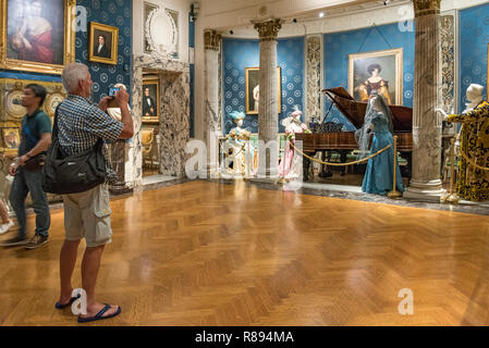 Horizontal view of a tourist inside the Scala museum in Milan, Italy. - Stock Image