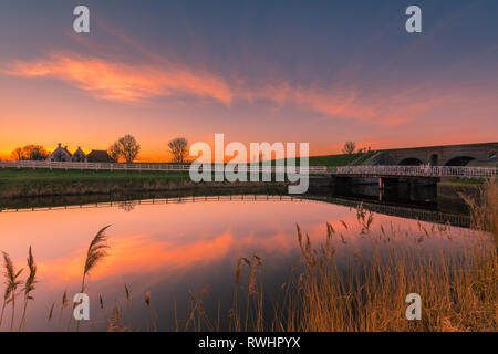 't Waarhuis  (de Koning en de Dame) along the Reitdiep canal in Aduarderzijl at sunset in the province of Groningen, Netherlands - Stock Image
