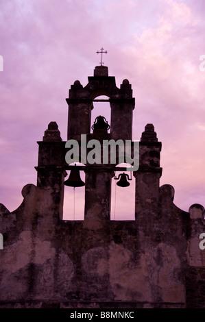 Mission San Juan Capistrano bell tower San Antonio Texas tx dramatic purple sky silhouette - Stock Image
