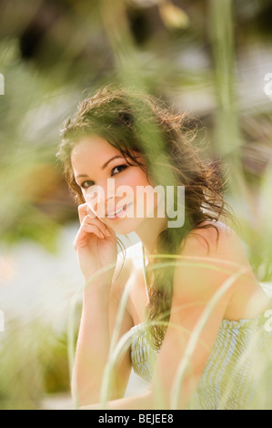 Portrait of a young woman day dreaming - Stock Image