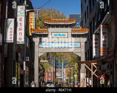 MONTREAL, CANADA - NOVEMBER 4, 2018: Paifang Monumental gate materializing the entrance to Montreal Chinatown. it is the Chinese ethnic district of th - Stock Image