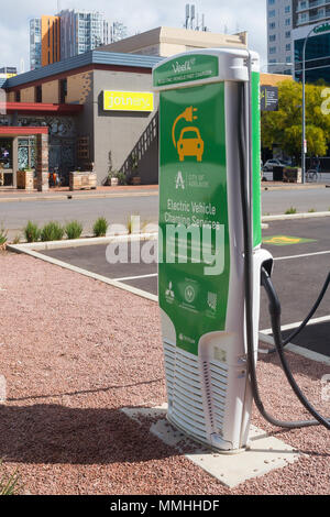 View of an electric car charging station located next to a car park near Bowen Street in Adelaide, South Australia, Australia. - Stock Image