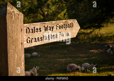 UK, Yorkshire, Wharfedale, Linton Falls, Dales Way wooden public footpath sign to Grassington - Stock Image