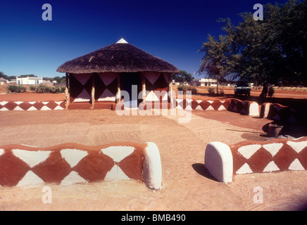 Traditional decorated mud huts - Stock Image