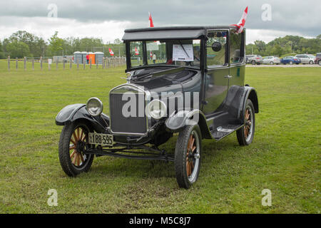 1926 Ford Model T Antique Car in a field at a Canada Day Celebration - Stock Image
