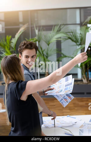 Colleagues discussing papers and project - Stock Image