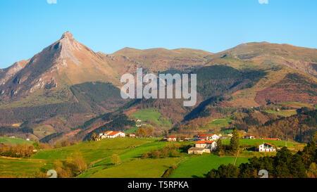 Panorama of farms in Lazkaomendi in Gipuzkoa with Txindoki mountain - Stock Image
