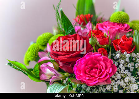 rose bunch, green tones, beautiful bunch of flowers, flower boquet, pink and red roses - Stock Image