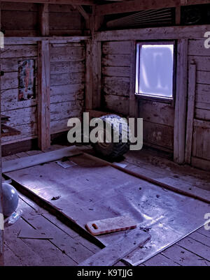Deserted Shed  and tire in Nova Scotia, Canada - Stock Image