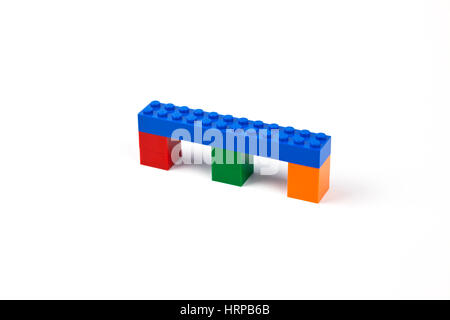 Blue bridge or viaduct model of Lego bricks or pieces resting on three piers. - Stock Image