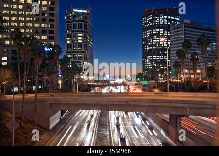 US 101, Harbor Freeway LA skyline, Dusk Los Angeles, California, USA Traffic moving CA city scape night - Stock Image