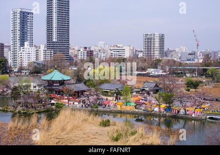 Bentendo with Shinobazu Pond at Ueno Park, Tokyo during cherry blossom season with a small festival on the grounds - Stock Image